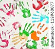 Seamless pattern, prints of hands - stock photo