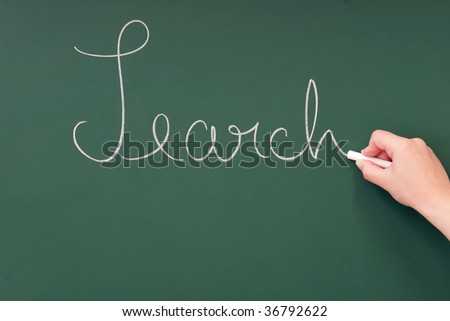 Search written on a blackboard with chalk