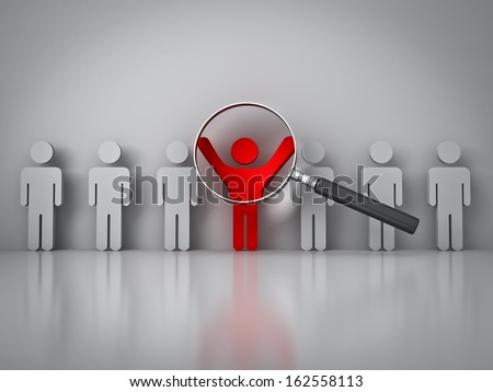 Searching for the right person concept , Magnifying glass focusing on the red man standing with arms wide open on white wall with reflection