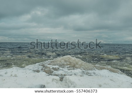 Seaside in winter, seashore, waves and ice in water time. Baltic sea.
