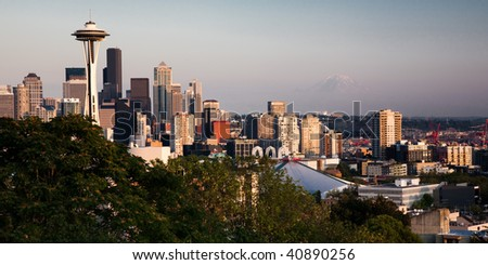 Seattle skyline at sunset with the snow cap of Mt. Rainier in the background