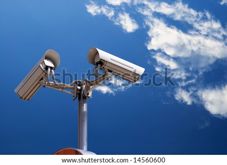 security camera on the blue sky