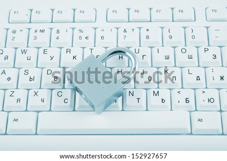 Security concept, padlock on white computer keyboard