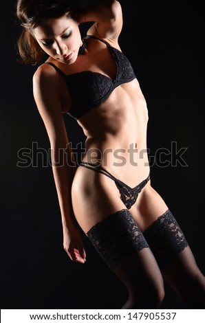 Seductive girl in lingerie on dark background