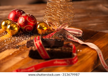 Selection of Christmas snacks and decorations on a wooden table