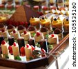 Selection of decorative desserts on a buffet table at a catered luxury event or celebration - stock photo