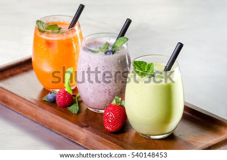 selection of fresh fruit vegetable juice smoothie raw organic strawberry pomegranate apple mint kale diet no sugar healthy lifestyle glass