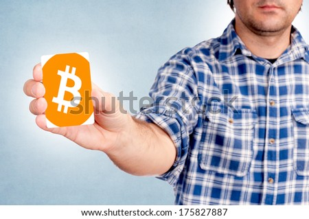 Selective focus on the bitcoin card in mans hand