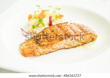 Selective focus point on Salmon fillet steak in white plate - Healthy food style
