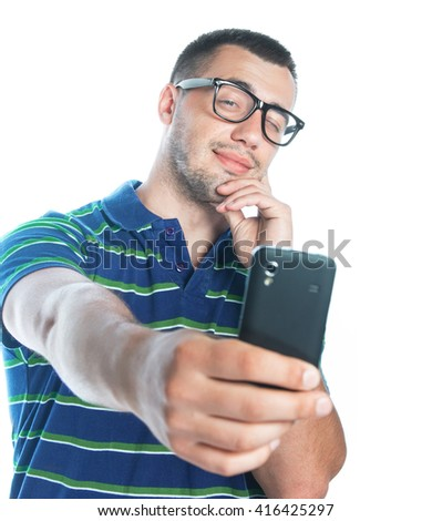 Selfie. Happy young man taking a selfie photo, isolated on white background, studio shot.