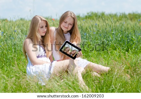 selfshot or selfy portrait: Two happy smiling pretty young women teen ...