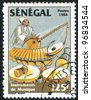 SENEGAL - CIRCA 1985: A stamp printed by Senegal, shows Musician playing balaphone, drums, circa 1985 - stock photo