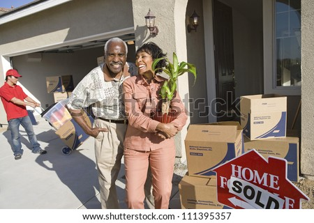 Senior African American couple moving to their new house