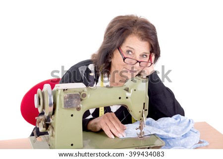senior beautiful lady working with sewing machine