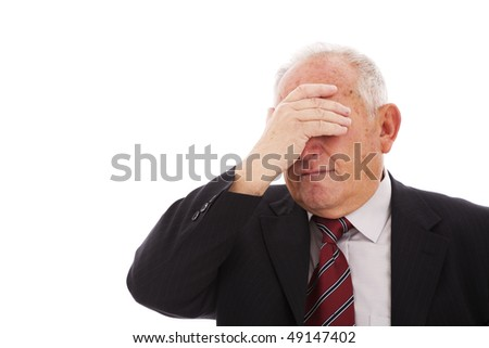 senior businessman hiding is face (isolated on white)