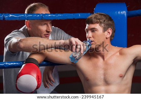 stock-photo-senior-coach-advising-boxer-