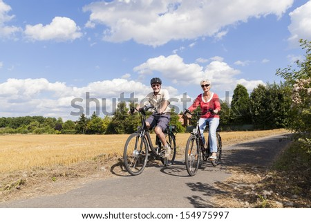 senior couple enjoying bike trip