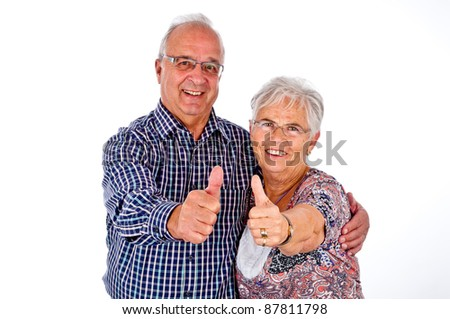 senior couple holding her thumb up