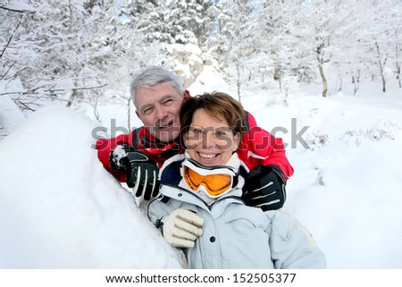 Senior couple in snowy landscape