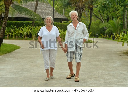 Senior couple near hotel resort