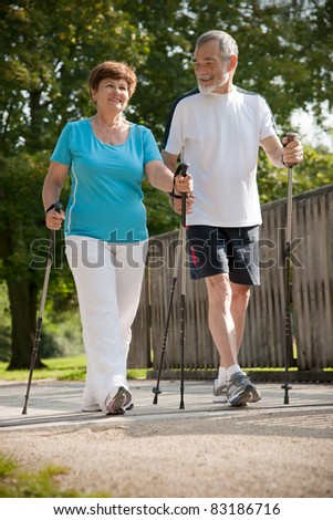 Senior couple Nordic walking