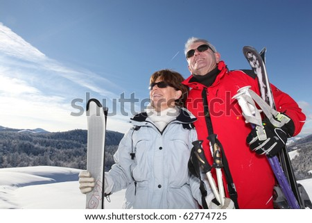Senior man and woman in snow