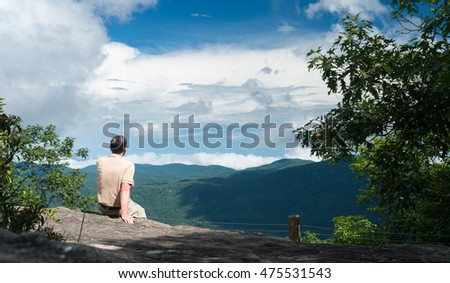 Senior man looking at view from the trail to the summit of Whiteside Mountain near Highlands and Cashiers in North Carolina