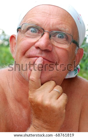 senior man making funny faces outdoor on a hot summer day