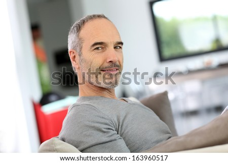 Senior man relaxing in sofa at home