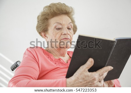 Senior old woman reading in her retirement home