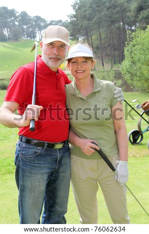 Senior people on golf course