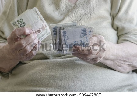 senior woman counting money (turkish lira)