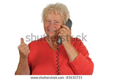 Senior woman makes OK gesture with a telephone