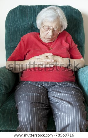 Senior woman napping (indoor chair)