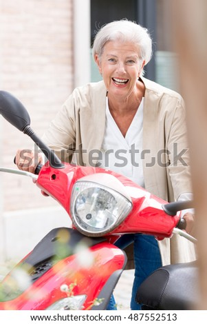 Senior woman on a scooter