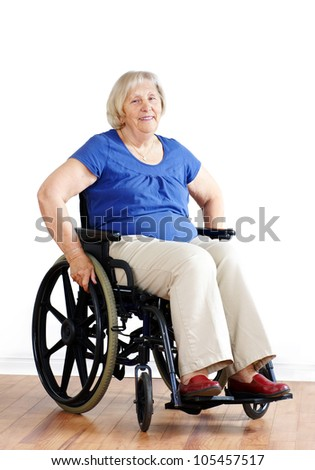 Senior woman patient in a wheelchair on white.