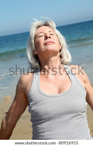 Senior woman relaxing on the beach