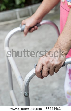 Senior woman using a walker