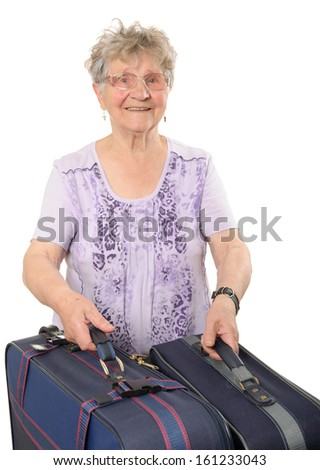 Senior woman with suitcases isolated on white