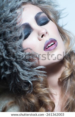 sensual blonde woman with shiny curly silky hair and a headpiece