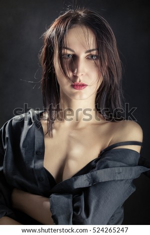 sensual woman with bare shoulder on black background