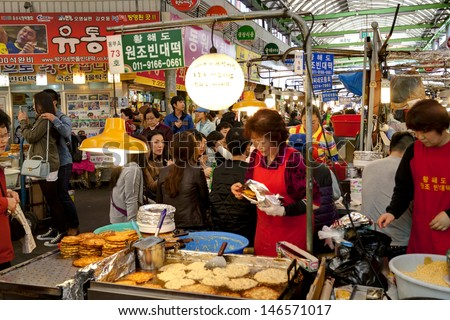 SEOUL KOREA APRIL 27: Vendors cooking traditional food for visitors at the Gwangjiang Market which is the nation's first market on april 27,2013 in  Seoul, Korea.
