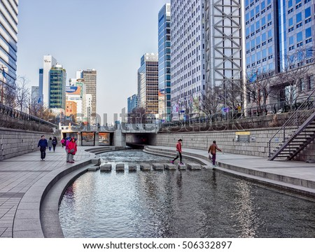 Seoul, South Korea - March 11, 2016: Urban park at Cheonggyecheon public walkway in Seoul, South Korea. People passing by