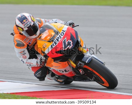 SEPANG, MALAYSIA - OCT 24 : Italian Andrea Dovizioso of Repsol Honda Team takes a corner during qualifying session at Shell Advance Malaysian Motorcycle Grand Prix on October 24, 2009 in Sepang