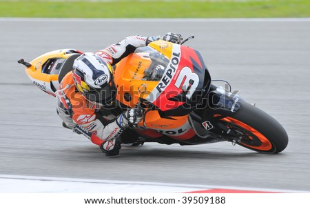SEPANG, MALAYSIA - OCT 24 : Spanish Dani Pedrosa of Repsol Honda Team takes a corner during qualifying session at Shell Advance Malaysian Motorcycle Grand Prix on October 24, 2009 in Sepang