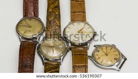 series of wristwatches, antique watches, top view, white background