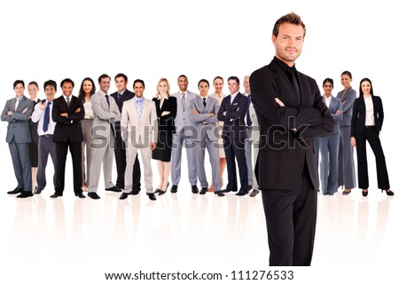 Serious businessman crossing his arms against a white background