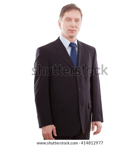 Serious businessman in a suit and tie. A middle aged man on white background