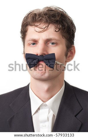 serious businessman with a butterfly tie on a white background