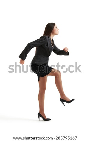 serious businesswoman in formal wear doing one step and looking up. isolated on white background